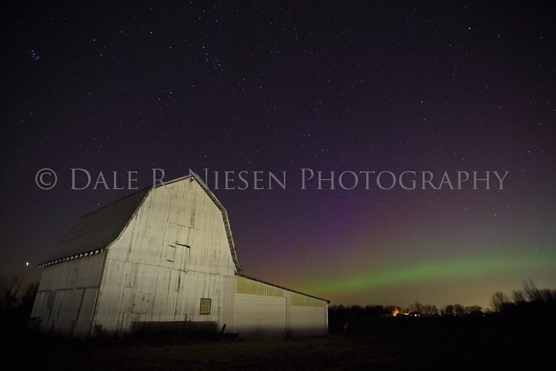 The Aurora Borealis over the farms of western Monroe County, Michigan near the town of Dundee on March 17, 2015.  With the aid of a passing car the barn was nicely illuminated.