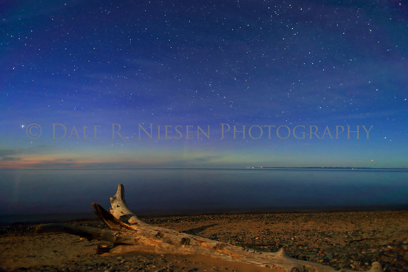 Whitefish Point June 5, 2014.  Faint aurora low at the horizon with air glow above and moon light on the beach make for soft pastel like colors in this capture over Lake Superior at Whitefish Point.  .