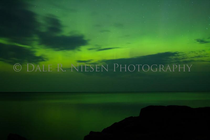 The aurora over the rocky coast of Lake Superior at Hunter's Point, Copper Harbor, Michigan