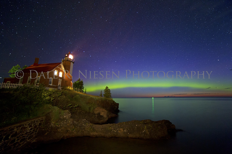 Eagle Harbor Lighthouse, Eagle Harbor, Michigan taken July 7, 2016 at 3:32 am during the early stages of dawn light from the sun is seen at the horizon.