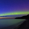 Sunset Aurora as the sun went down the Aurora Borealis battles the sun light for the skies over the Sleeping Bear Dunes..  Taken on May 7, 2016 at 10:15 pm looking north toward the Empire Bluffs in the Sleeping Bear Dunes National Lakeshore.  Note the two white lines in the sky are satellites passing over head.