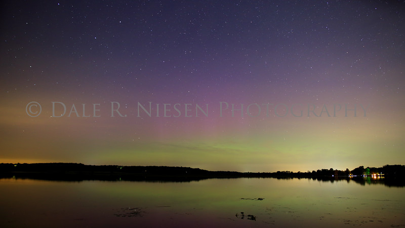 The aurora was somewhat obscured by clouds at the horizon,thin high level clouds and ambient light from three towns. This photo was captured in SE Michigan just south of Hell at Fourmile Lake in the Chelsea State Game Area near Chelsea, Michigan. Taken 8/15/2015 UTC 8/16/2015 ca. 11:00 PM EST.