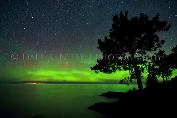 The aurora borealis and shoreline at Esrey Park, Eagle Harbor, Michigan.  Taken August 31, 2014 at 3:37 AM.