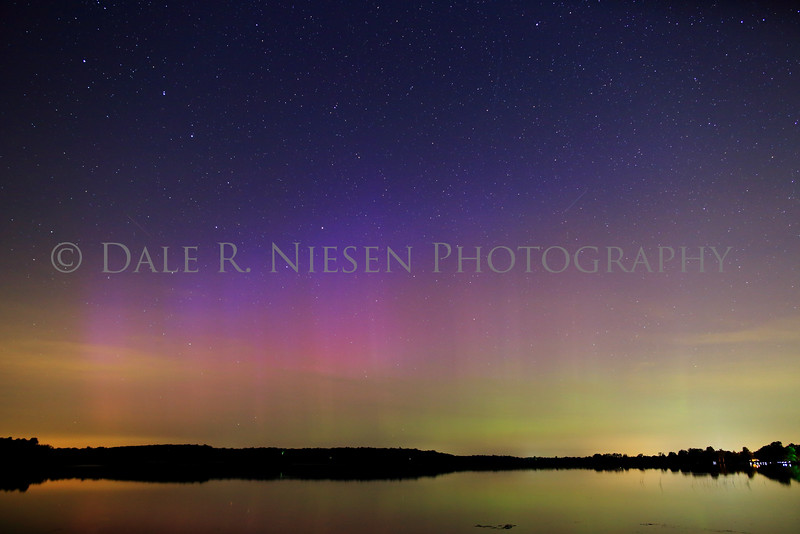The aurora was somewhat obscured by clouds at the horizon, thin high level clouds and ambient light from three towns. This photo was captured in SE Michigan just south of Hell at Fourmile Lake in the Chelsea State Game Area near Chelsea, Michigan. Taken 8/15/2015 UTC 8/16/2015 ca. 11:00 PM EST.