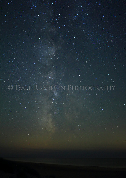 The Milky Way and aurora or air glow over Lake Michigan from Little Sable Lighthouse near Silver Lake, Michigan.