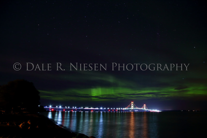 The Aurora Borealis battles clouds for the sky above the Mackinac Bridge in early hours of October 8, 2015.
