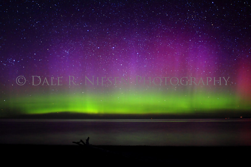 The above image is part of a series of photos nine of which are  posted to this gallery.  These images show the evolution of a rainbow like display of Aurora Borealis or Northern Lights over Lake Superior at Whitefish Point taken 5/6/2013 near Paradise, Michigan.  It was a calm night on the lake allowing for a wonderful reflection of the lights.