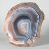 "#0578 Paso Berwyn Agate, Chubut Province, Patagonia, Argentina<br /> Throughout this agate one sees the gentle chromatography of the agates of Chubut, so different from the bold dramas in the Condor agates from about 800 miles to the north. Long exposure to the temperature extremes of the Chubut desert has caused a couple of stress fractures. The outer surface is soothingly smooth from the sand blasting winds. <br /> 3 x 2 1/4 x 1"" 0.43 lb<br /> All agates in the sample galleries have been SOLD."