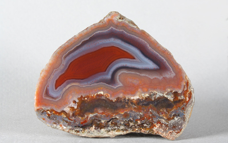 "#0582 La Manea Agate, Chubut Province, Patagonia, Argentina<br /> This is one of the best classic La Manea agates I have seen, great ruin agate below a sharply banded fortification agate with striking colors, the reddest red. The outer rosy pink area ties in with the colors below. Flawless.<br /> 2 1/4 x 1 3/4 x 1 1/4"" 0.28 lb<br /> All agates in the sample galleries have been SOLD."