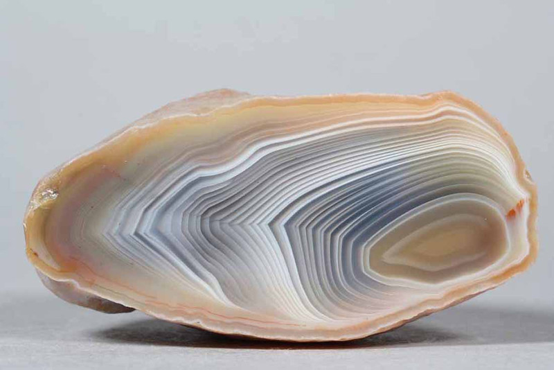 """#0297 Paso Berwyn Agate, Chubut Province, Patagonia, Argentina<br /> Powerful shadow effects move boldly along both sides of the pointed border between the two halves. Flawless agate.<br /> 2 1/2 x 1 1/2 x 1 1/2"""" 0.22 lb<br /> All agates in the sample galleries have been SOLD."""