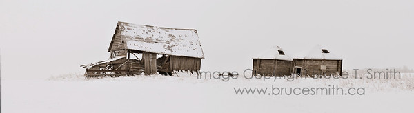 Abandoned farm buildings in the snow - panorama
