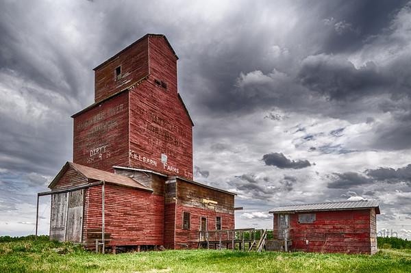 Old wooden grain elevator near Tofield, Alberta.