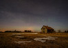 Abandoned farm and aurora
