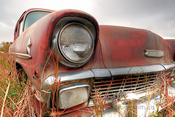 Old rusty Chevrolet headlight and front end
