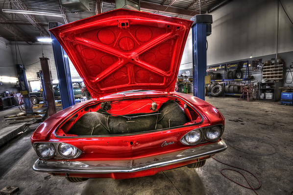 The front end of a Red Corvair.