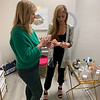 Danielle shows Elaine Zouzas Thibault of Chelmsford all of the new Beautycounter products