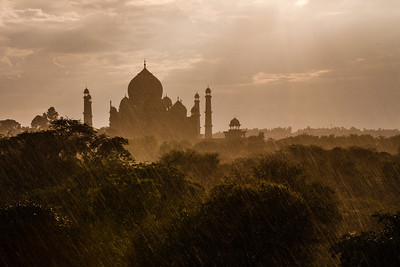 Taj Mahal seen in silhouette from a vantage point in the nature trail on the east side in the rains