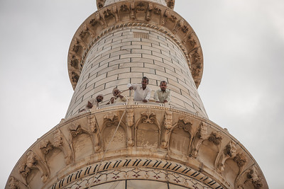 People doing some repair work on the pillar of the famous UNESCO world heritage site, the Taj Mahal in Agra, India.