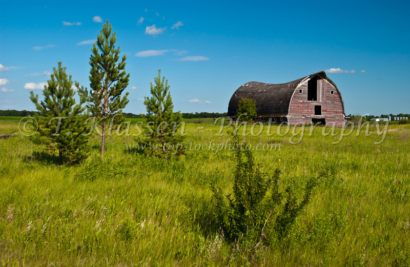 An old barn with a broken back near St. Agathe, Manitoba, Canada.