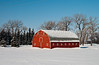 A red barn in winter near Myrtle, Manitoba, Canada.