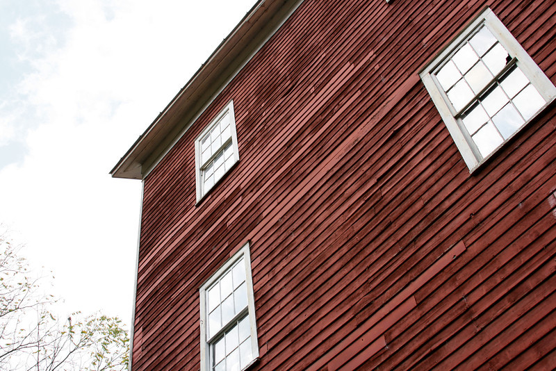 Looking up at a stately red barn.