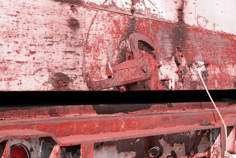 Detail of rusted metal and decaying wood on an old tractor trailer.