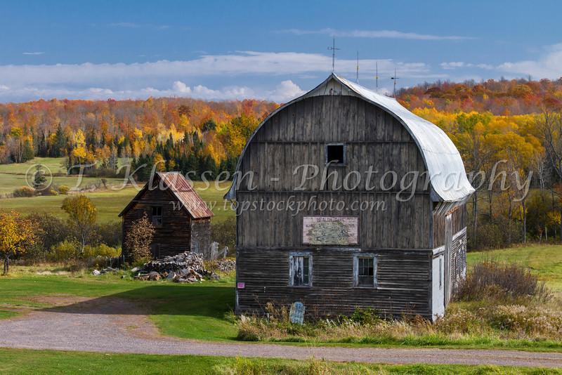 A barn with fall foliage color in rural Michigan, Upper Peninsula, USA.