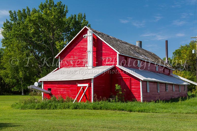 A red barn at the Elias Seed Farm near Blumenfeld, Manitoba, Canada.
