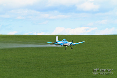 Crop Dusting - An aerial applicator flying a Cessna AGhusky airplane to spray a field!