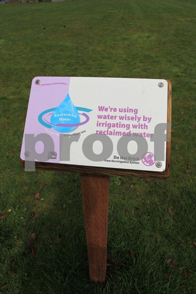 "Olympia, WA, Pubnlic Works sign, ""We're using water wwisely by irrigating with reclamed warter."""