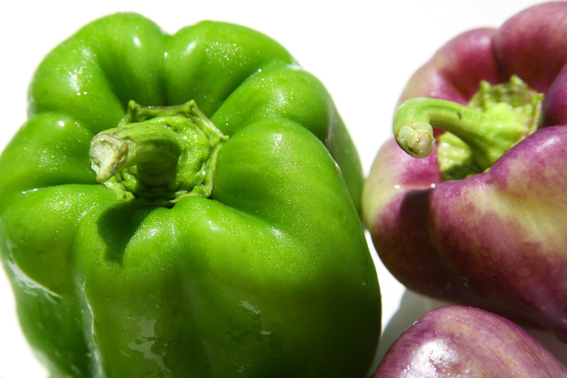 Purple and green peppers.