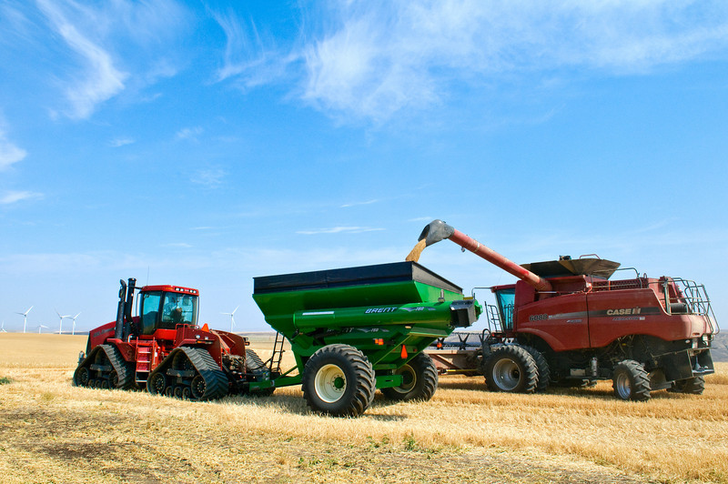A combine unloads into grain cart while harvesting wheat in Eastern Washington