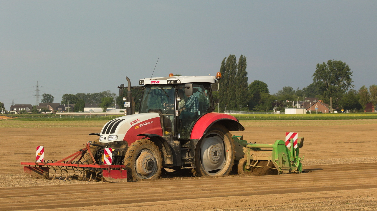 Steyr 6140 Profi with front harrow and bed former.