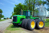 John Deere tractor at the driveway entrance to the Froese farm at Reinfeld, near Winkler, Manitoba, Canada.