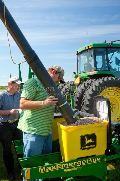 Loading a bean planter at the Froese farm near Winkler, Manitoba.
