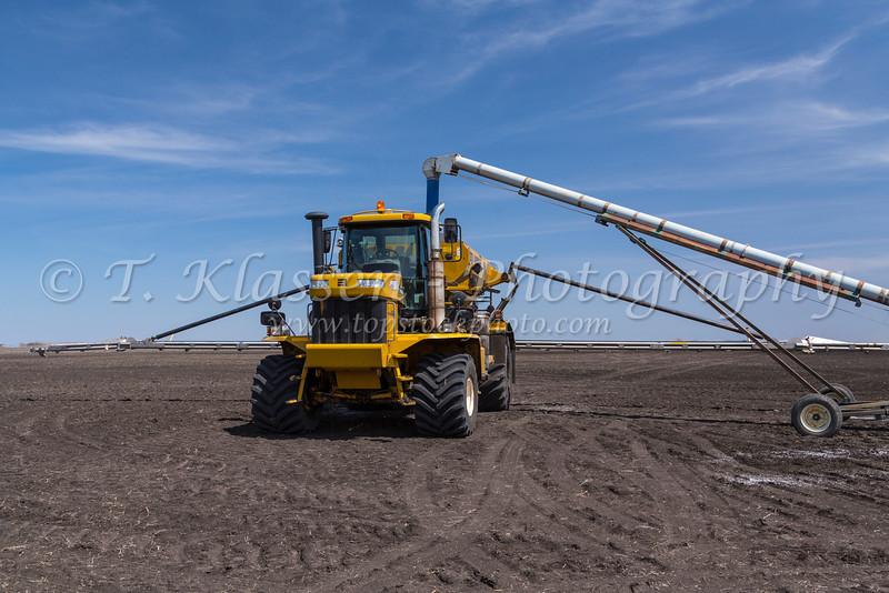 Loading the AirMax 1000 Terra-Gator fertilizer spreader on the Froese farm near Winkler, Manitoba, Canada.