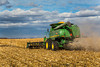 A John Deere combine harvesting corn on the Froese farm near Winkler, Manitoba, Canada.