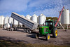 Unloading beans into hopper bins at the Froese farm near Winkler, Manitoba, Canada.