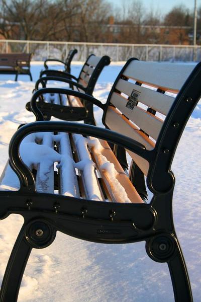 Winter wonderland: a park bench in crisp morning light awaits the first weary traveler.