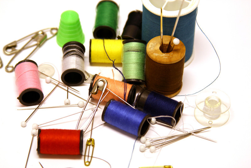 Sewing notions. Old wooden spools and various colors of thread.