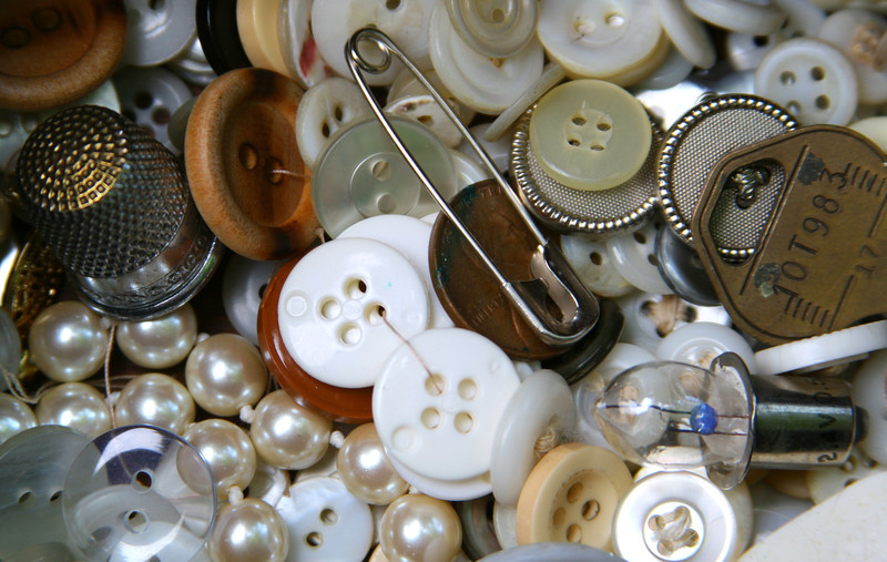 Backdrop of buttons and sewing notions.