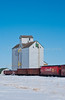 The St. Agathe Co-operative elevator with train boxcars in winter, Manitoba, Canada.