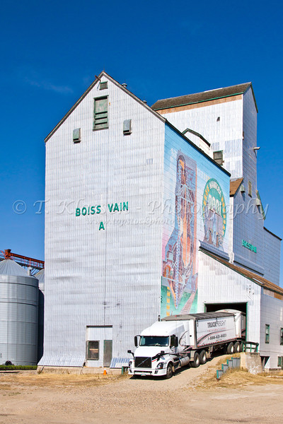 A large truck making a delivery at the former Pool elevator building in Boissevain, Manitoba, Canada.