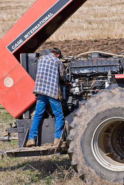 Repairing a tractor during spring ground work
