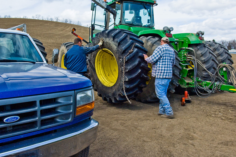 Tire technician replaces a tire on a large tractor