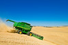 A combine harvests wheat in the Palouse region of Washington