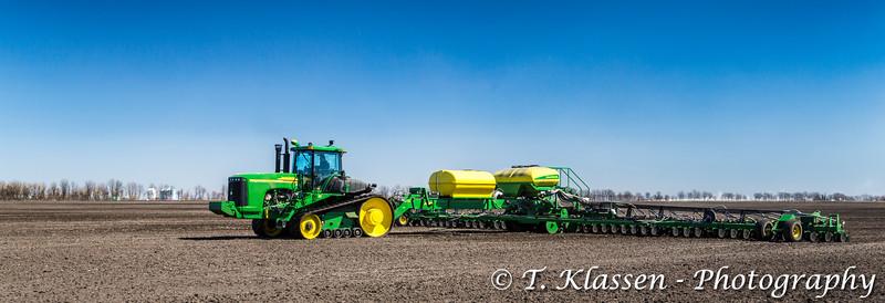 John Deere grain seeding equipment on the field near Plum Coulee, Manitoba, Canada.