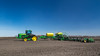 John Deere grain seeding equipment on the field near Plum Coulee, Manitoba, Canada.