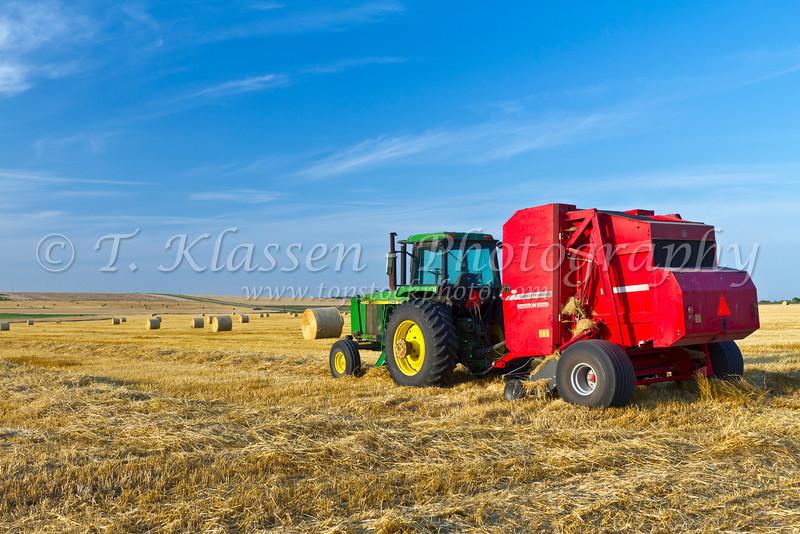A hay baler on a field near Manitou, Manitoba, Canada.