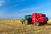 A hay baler on a field near Manitou, Manitoba, Canada.